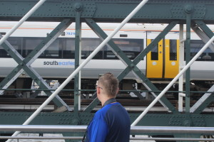 This guy bloody loves trains