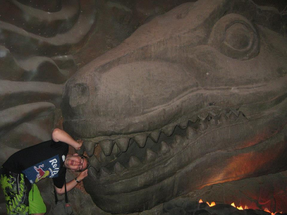 To express my gratitude, here's me being hilarious with a statue T-Rex in Thailand.